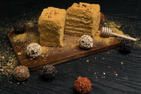 sweet homemade honey cake on a black wooden table