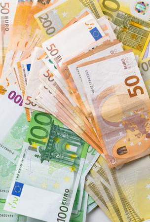 different euro cashin background Stock Photo