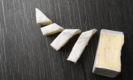 camambert blu cheese on the black background