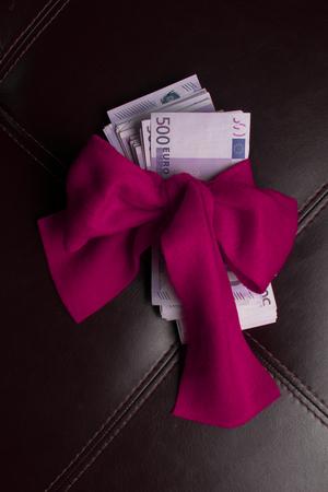 euro cash gift bow Stock Photo