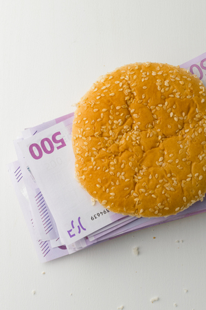 hamburger filled with euro money Stock Photo