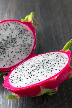 exotic organic fresh dragon fruit pitaya on the black table Stock Photo