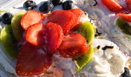 Mascarpone pavlova cake with strawberry, kiwi, blueberry. Cream dessert