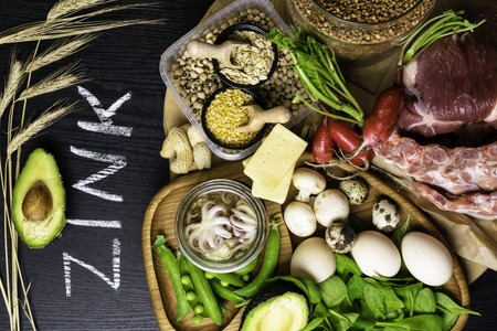 Foods Highest in Zinc as octopus in oil, beef, buckwheat, yellow cheese, spinach, avokado,pea, mushrooms, bean, radishes eggs with inscription Healthy diet food Top view Stock fotó
