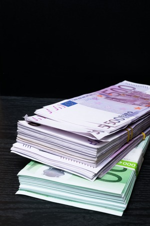 Euros money stack isolated on black background Stock Photo
