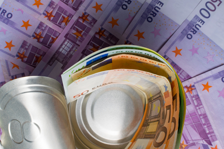 Sardine can filled with euros paper money on the 500 euros background. Money conservation concept Stock Photo