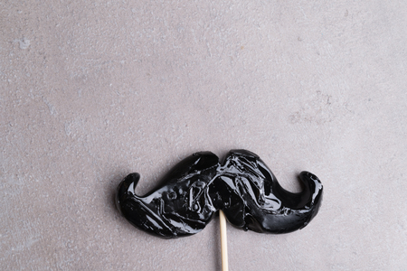 mustache black on a stick isolated on grey background, Mens day, Father day