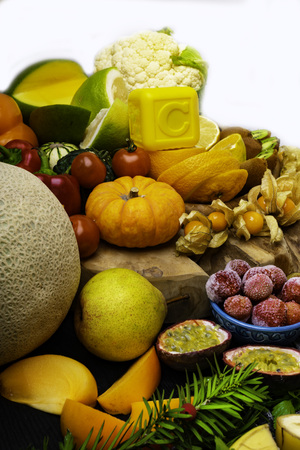 Vitamin C in fruits and vegetables. Natural products rich in vitamin C as needles, oranges, lemons, pepper, kiwi, parsley leaves, garlic, bananas, mango, cabbage, melon, berry, pumpkin, tomatoes, mango, persimmon, passion fruit physalis kiwi fig raspberry strawberry pear