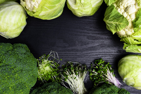 cauliflower, white cabbage, broccoli, greens radish, cress salad, arugula, mustard sprouts. Healthy lifestyle, stay young and modern restaurant cuisine concept isolated on wooden background