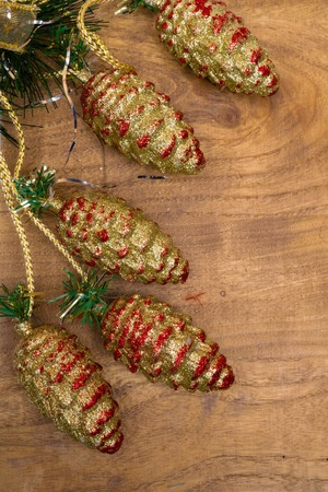 Christmas and New Year card on wooden  with snow fir tree, pine cones.