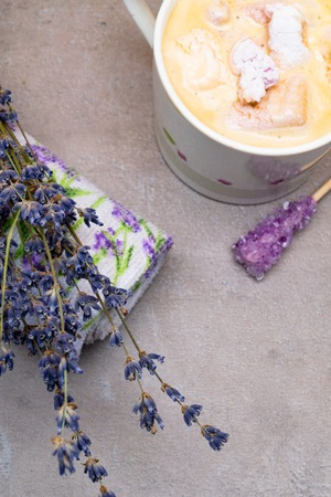 relax spa lavender mood coffee, violet candy sugar on wooden stick, marshmallow, lavander print towel and bunch of flower. Imagens