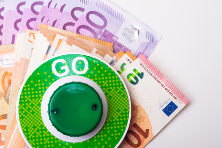 GO green sign with euro money cash background, success concept Stock Photo