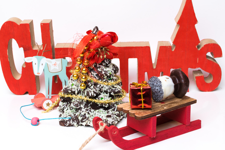 Chocolate Christmas tree on the festive table with wooden text - christmas, copy space