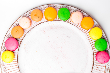 french macarons for sale on white plate, copy space