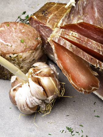 Smoked ham, jerky corned beef on table with garlic Natural product from organic farm, produced by traditional methods Stock Photo