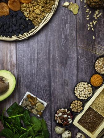 Foods High in Zinc as spinach, mushrooms, pumpkin seeds, garlic, bean, cedar nuts, avocado, eggs, raisins, ginger, walnut, apricots, Top view 写真素材