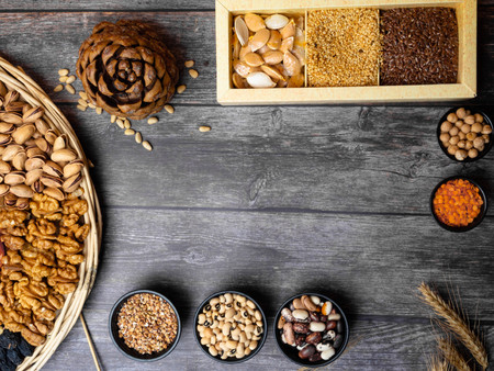 Natural cereal grain food consisted of pistachio, seed, bean for agricultural product concept and carbohydrate food on wooden background Zdjęcie Seryjne