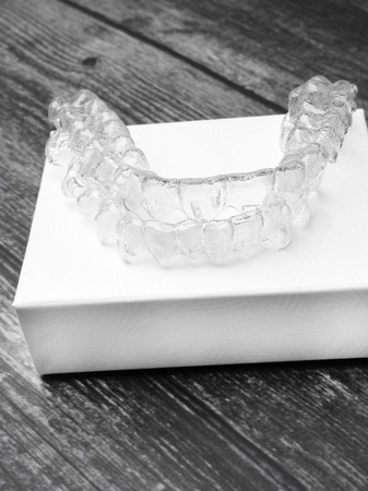 Invisalign braces. Invisible brackets on white box