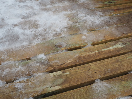 Wooden surface covered with snow - Winter material