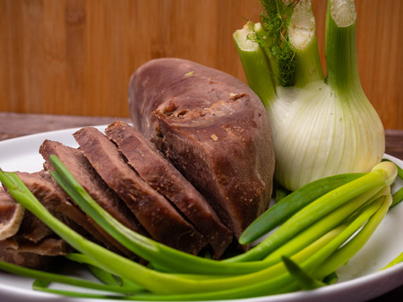 pork or beef tongue slices with chinese cabbage, green onion, fennel on wooden background, gourment food conception Foto de archivo