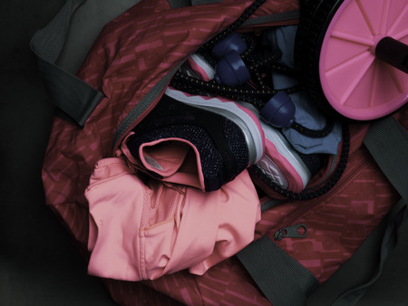 sport bag with fitness set, shoes, expander, roll for press, motivation and health lifestyle concept Фото со стока