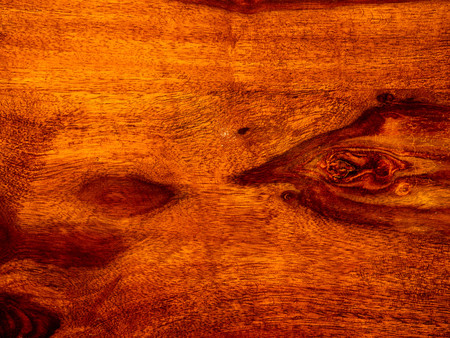 that acacia timber, trim with rosewood red wooden background, vintage surface Фото со стока