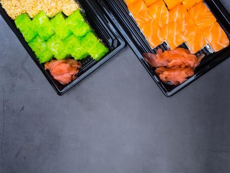 Sushi Roll with salmon, eel, tuna, avocado, royal prawn, cream cheese Philadelphia, green and orange caviar. Sushi menu. Japanese food. Imagens