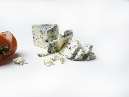 Cheese with a mold, Blue cheese with red tomato isolated on white, copy space