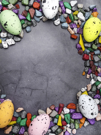 Delicious chocolate sweets, easter eggs on grey background, space for text Stockfoto