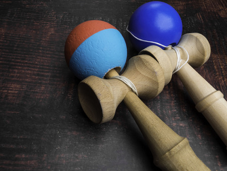 Classic Japanese game kendama on wooden background. Two playing kendamas, competition concept Reklamní fotografie