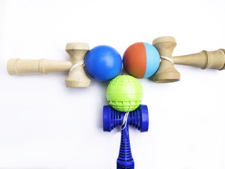 Traditional Japanese toy Kendama on white background, close up Japan wood toy, colorful toy