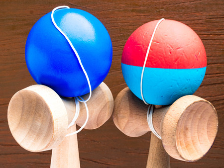 Classic Japanese game kendama on wooden background. Wooden playing kendamas, competition concept