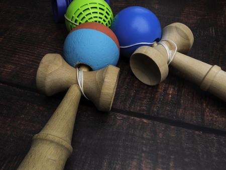 Traditional Japanese toy Kendama on dark background, close up Japan wood toy