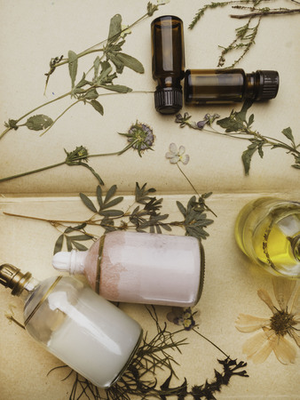 Styled beauty background, web banner. Skin mask, tonicum bottle, dry flowers, leaves. Organic cosmetics, spa concept. flat lay top view