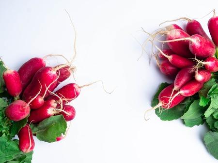 Fresh bunch of radish on white table