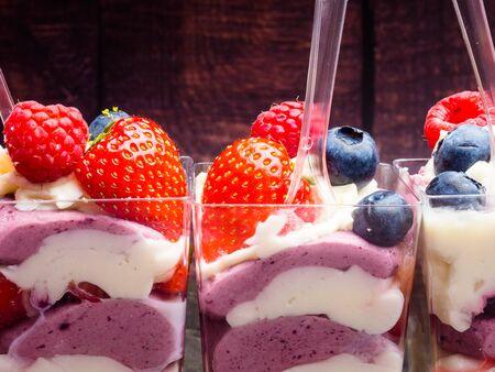 Refreshing dessert: Ice cream, berries, nuts, sorbet, jam and biscuit summer dessert sweet snack