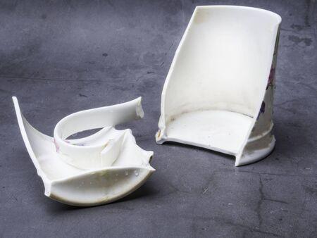 Broken white cup pieces