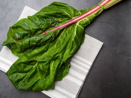 Fresh raw leaves of chard, mangold, swiss chard on a kitchen towel