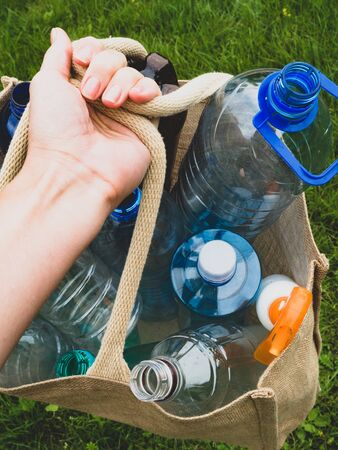 plastic bottles in Eco friendly bag for shopping - linen, burlap, mesh bag. Zero waste background Reklamní fotografie
