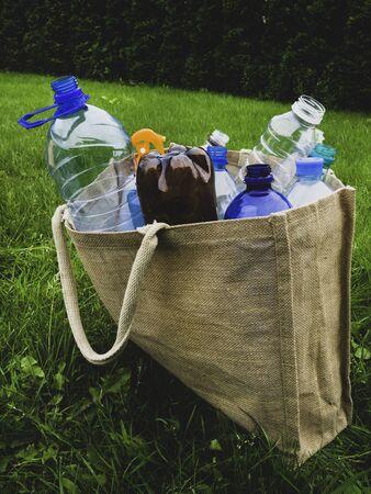 Eco friendly bag for shopping Ecological burlap bag and plastic bottles inside. Zero waste shopping concept.