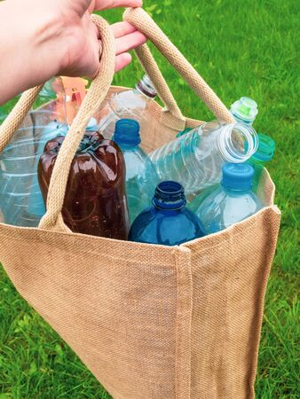 cotton bags and plastic bottles inside Refuse plastic . Refuse, reduce, recycle and zero waste concept. Ecology, safe nature. Reklamní fotografie
