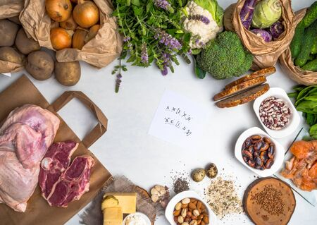 Super food for body builders with lean meat, dairy products, spinach, mint, vegetables, beans, salmon fish and vitamin pills on green wood background. Stok Fotoğraf