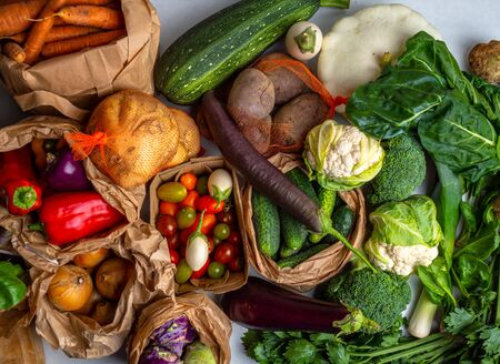 Healthy vegetarian seasonal food cooking background. Flat-lay of Autumn vegetables and herb as parsley, spinach, mangold, top view, copy space. Clean eating, alkaline diet food, colorful vegetables rich in fiber, antioxidants