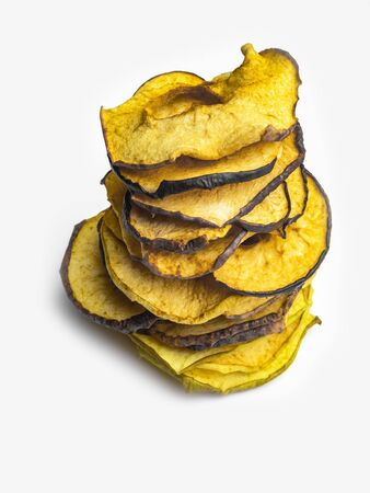 Tasty apple chips isolated on white, healthy vegan vegetarian fruit snack or ingredient for cooking, copy space
