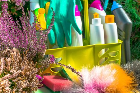 close up of Spring cleaning concept with supplies, colorful sprays, bottles and rubbers with flower Stockfoto