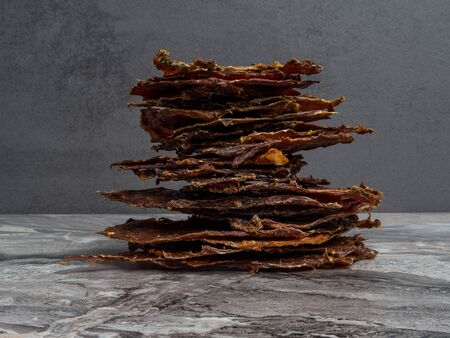 tower of dried or dehydrated meat slices, copy space Stock Photo