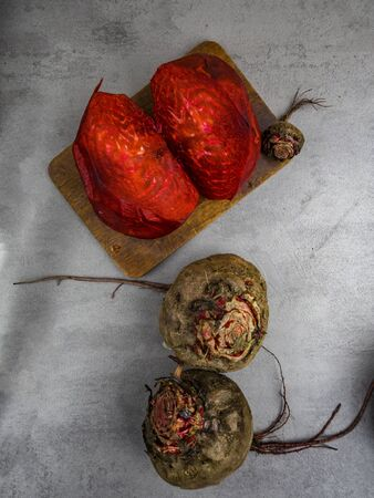 Composition with whole and cut beets on grey background, top view, copy space