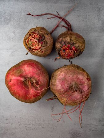 Beet, beetroot bunch on grey stone background. Copy space. Top view. Anticancer diet