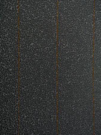 Rain drops against dark glass background, wet weather concept, selective focus