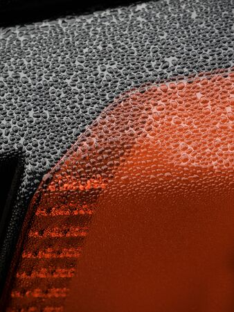 Wet beautiful car Headlamp, black car with water drop. Close up Side view shot from side of vehicle. Detailing concept. Stok Fotoğraf